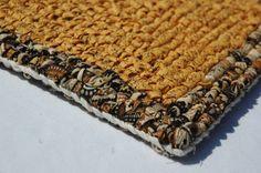 Yellow and brown trivet using locker hooking.