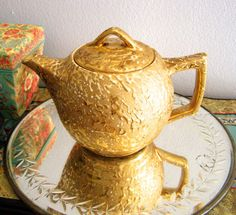 Hey, I found this really awesome Etsy listing at https://www.etsy.com/listing/168712418/vintage-ceramic-tea-pot-24k-weeping-gold