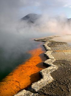 """Champagne Pool, WaiOtapu, New Zealand  """"The name Champagne Pool is derived from the abundant efflux of carbon dioxide (CO2), similar to a glass of bubbling champagne. The hot spring was formed 900 years ago by a hydrothermal eruption, which makes it in geological terms a relatively young system."""""""