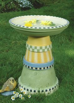 Love the paint job on this Painted  Birdbath made with flower pots and a large saucer for the top.