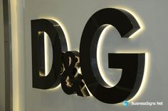 3D LED Back-lit Signs With Mirror Polished Titanium Plated Letter Shell And 10mm Thickness Acrylic Back Panel For Dolce & Gabbana. The Mirror Polished Titanium Plating is different with the Gloss Paint In Black. Could make the signage luxury. If you need to custom signs like this, please click the image then fill out the form and tell us your needs now.
