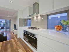 Gorgeous white kitchen with grey/brown splashback