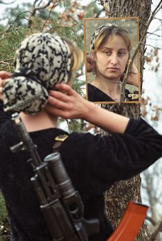 Chechnya, Russia, Chechen insurgents' wife on a mountain base, December 1999.  Dmitry Beliakov for The Sunday Times