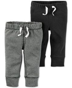 Ribbed cuffs and covered elastic waistbands enhance the comfort of this two-pack of pull-on pants for baby boy by Carter's. | Cotton | Machine washable | Imported | Two pack of pull-on pants | One sol