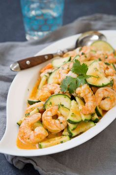 The flavors in this Thai Shrimp Stir Fry with Zucchini are beyond amazing! Plus, this healthy dinner comes together in about 25 minutes.
