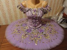 An adorable creation for the role of the Lilac Fairy. This tutu looks like an enchanted garden! The bodice is made using lilac lace and is entirely decorated with small lilac flowers and golden braids