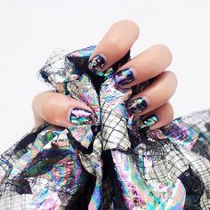 We're so honored @susiebubble featured her Urban Jungle mani in her latest blog post - an ode to oil slick. We're crazy about the polychromatic metallic look, too! Thanks, Susie!  #paintboxmani #nailart #oilslicknails