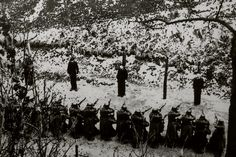 Photograph of the execution of members of the Manouchian Group, Resistance network of immigrant workers. Mont Valerien, France, February 1944.