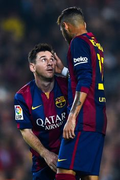 Lionel Messi of FC Barcelona chats with his teammate Neymar of FC Barcelona during the La Liga mach between FC Barcelona and Sevilla FC at Camp Nou on November 22, 2014 in Barcelona, Spain.