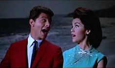 Frankie Avalon in a red suit jacket