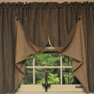 I love the way these curtains are done. Searching ideas for my primitive inspired living room.