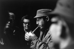 Henri Cartier-Bresson. CUBA. Havana. 1963. President Fidel CASTRO having attending a meeting on the reorganisation of the Party, during a 3 hours speech in the Teatro Chaplin in Havana, leaves the building and lights-up one of his famous cigars.