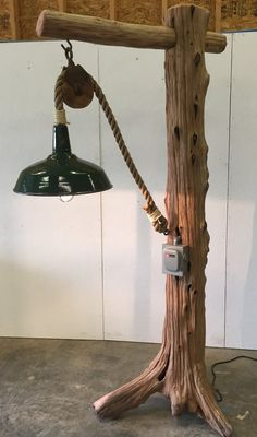 This statement floor lamp combines an awesome Cedar driftwood tree trunk with reclaimed farm and industrial components. Original, well-crafted, and at over 7 ft. tall, this lamp is perfect for a large foyer or great room. It is well-suited for damp locati Driftwood Flooring, Driftwood Lamp, Driftwood Crafts, Diy Flooring, Diy Floor Lamp, Modern Floor Lamps, Rustic Lamps, Rustic Lighting, Industrial Lighting