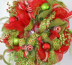 LadybugWreaths.com  Learn to make a Deco Mesh Christmas Wreath with Nancy!  http://ladybugwreaths.com/doorwreaths/brilliant-deco-mesh-door-wreaths-pin/#  Downloadable / Viewable Video is only $29.97