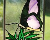 Spring and summer are always the season with this beautiful butterfly stained glass panel gracing your window.    I used a black antique and purple bullseye glass for the butterfly, a green Spectrum glass for the leaves and a leaf-patterned clear glass for the background. This would make a beautiful gift for any lepidopterist, Mothers Day or a special Birthday, for a Bride and Groom, for a Gardener, or for yourself!    The glass panel measures approximately 8x11 and is framed with a 3/8 ...