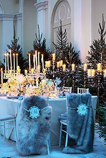 Faux fur chair backs for a luxury winter wedding. Styling, Laura Burkitt for Brides magazine. Photography, Mel Yates. Florist, Mary Jane Vaughan. Venue, Blenheim Palace