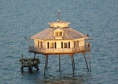 Middle Bay Lighthouse, also known as Mobile Bay Lighthouse, is a hexagonal-shaped screw-pile lighthouse offshore from Mobile, Alabama, in the center of Mobile Bay.