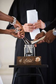 Creative ceremony idea: This couple had a salt unity ritual to represent their union coming together