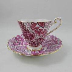 Beautiful tea cup and saucer made by Royal Standard. Tea cup and saucer are covered in pink paisley pattern. Gold trimming on cup and saucer edges, and on tea cup handle. Excellent condition (see photos). Markings read: Royal Standard Fine Bone China England Please bear in mind that
