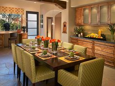 Sage, orange and yellow serve as a pleasing color combination in this tropical kitchen. To spice up the country, rustic wood furnishings and balance the two varying design styles, designer Amy Bubier added a sleek and contemporary dining table with simple upholstered chairs, as well as modern light fixtures and accessories to create a dynamic and vigorous atmosphere. hgtv.com