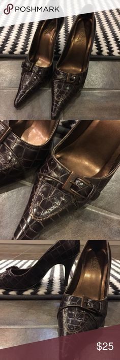 "CARLOS SANTANA Brown Croc Pattern ""Panache"" Heels Excellent used condition! These beauties feature a leather upper with an embossed crocodile pattern in a rich brown color. The to s feature a faux buckle which makes the design even more modern. Soles are in very nice condition, very minimally worn! Size 6 1/2. Carlos Santana Shoes Heels"