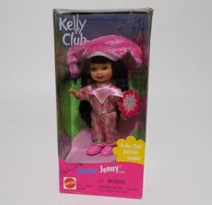 Jester Jenny Kelly Club Barbie's sister doll from Dressed in a pink and gold jester costume. Still sealed. Black mark on the lower front of box. Jester Costume, Club Poster, Barbie Sisters, Mattel Dolls, Pink And Gold, Baby Dolls, Costumes, Kitchen Stuff, 2000s