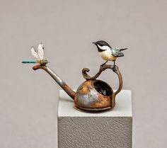 Our own wonderfully talented Beth Freeman-Kanes gorgeous Chickadee perched on a watering can observing a dragonfly made with real bee wings which I have in my collection!!!.Good Sam Showcase of Miniatures