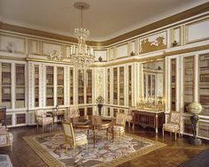 Louis XVI Library, Versailles<br />This room was originally constructed in 1774 (around the time of Louis XVI's ascension to the throne). For the collection, Mulvany and Rogers faithfully recreated the Rousseau brother's setting, which incorporates beautiful neoclassical panelling. The library table originally made in 1774 by Jean-Henri Riesener is the perfect centrepeice for the room. Hillman recreated this along with the three other Riesener pieces shown.