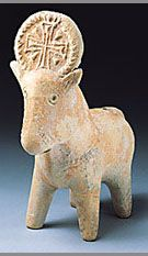 A Byzantine-period pottery zoomorphic vessel from Hagosherim, Israel, in the shape of an animal with a Christian cross in a wreath crowning its head. (Photo: The Israel Museum, Jerusalem/by Avraham Hay)