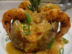 This is the BEST stuffed potato you will ever eat! Stuffed with crawfish and shrimp then topped with a creamy sauce and more crawfish…you might fall in love