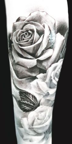 Nice black and grey roses by Eric Marcinizyn #InkedMagazine #roses , wants these on my arm