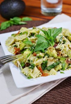 Avocado & Basil Pasta ~ loads of fresh basil and avocado with a touch of bacon, comes together quickly, & delivers huge flavor.  It may just become a new weeknight favorite!  www.thekitchenismyplayground.com