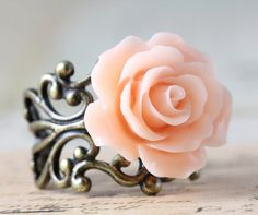 Rose Ring Flower Rings Peach Pink Bridesmaids Gift Wedding Jewelry - Brass or Silver Handmade by Inspired by Elizabeth. $11.75, via Etsy.