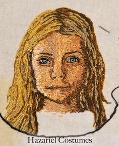 Small embroidered portrait. Embroidery thread painting