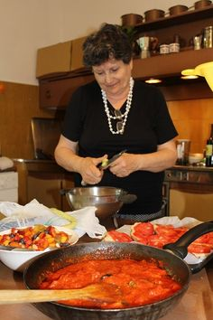 The chef in action! Its her kitchen, don't you forget it!!  .  #learnitalian #studyitalian #studyinitaly #travelitaly #italianculture #italianlanguage
