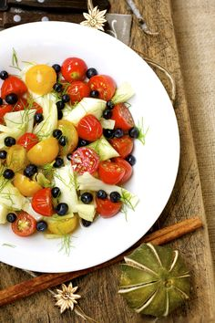 This Tomatoes, Blueberries & Fennel Salad is crisp, juicy, and so good!  It's so nice to have a different kind of salad now and then. #fennelsalad