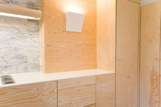 Plywood and marble kitchen
