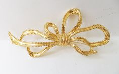 Vintage jewelry brooch in gold bow design by DevineCollectible
