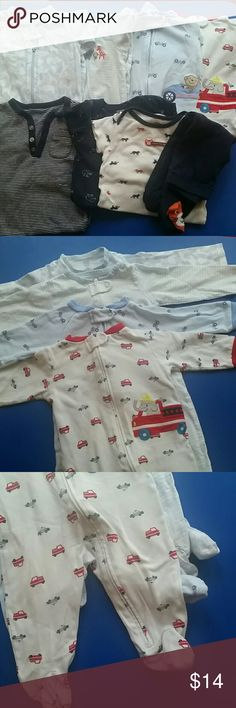 Just One You and Carters Baby Clothes (9 months) Gently used, clean.  4 long sleeve zipper onesies with closed feet (pic 1 and 2). 1 long sleeve with onesie covering feet;  1 long sleeve onesie but has no covering on bottom;  one short sleeve onesie with matching pants (picture 4) One Pieces