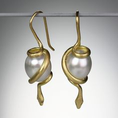"""Gabriella Kiss...A pair of 18K yellow gold spiral snakes wrapped around white South Sea pearls, measuring approximately 1.75"""" long."""