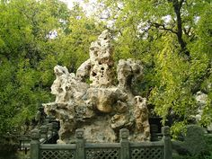 """Philosopher's Stone at the Forbidden City.  Beijing, China. Naturally formed or """"sculptured"""" stones in surprising shapes and textures, Gongshi have been appreciated in Chinese gardens as early as the Tang dynasty (618-907AD).  It was said that a garden could not be beautiful without such rare rocks, and that a studio lacked elegance without gongshi."""