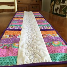 A personal favorite from my Etsy shop https://www.etsy.com/listing/227314225/modern-quilted-table-runner-in-vibrant