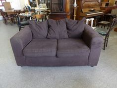 Brown two seater sofa, measurements are H-71cm W-153cm D-88cm ---------------- £40 (pc022)