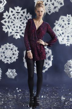 Pair a romantic romper with black tights for some winter spirit.