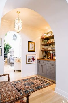 this is sooooo my style! super eclectic, modern, mission style, with some warm colors white walls and bohemian rugs!