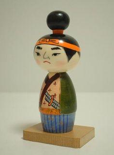Musashi by Chie Tamura. This kokeshi is a model of the powerful Japanese Master swordman, Musashi Miyamoto Momiji Doll, Kokeshi Dolls, Japanese Gifts, Japanese Paper, Miyamoto Musashi, Paint Line, Fabric Toys, Japan Style, Plushies