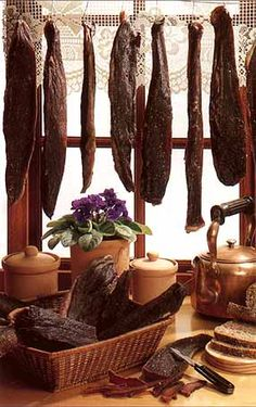 Google Image Result for http://www.biltongbeli.com/images/biltong2.jpg  This is really a tasty treat. Droe wors is dried sausage but using ground meat instead of chunks of meat.