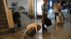 I need to buy hubby a much bigger suitcase for christmas so that he can drag me around like this at the airport (gif)