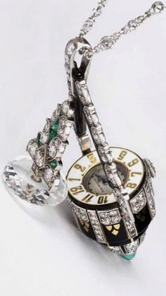 Morelle Davidson's vintage Boucheron platinum and gold pendant watch is enamelled in black and white, with rock crystal covering the watch face, which can be moved to read the time.