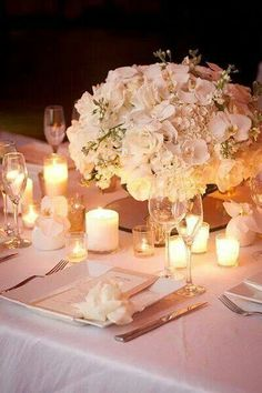 Simple candles and flowers create a romantic feel during your wedding reception.